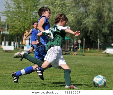 KAPOSVAR, HUNGARY - JUNE 12: Armin Prukner (R) in action at the Hungarian National Championship under 13 game between Kaposvari Rakoczi and Tatabanya June 12, 2010 in Kaposvar, Hungary.
