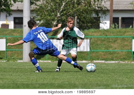 KAPOSVAR, HUNGARY - JUNE 12: Adam Klausz (L) in action at the Hungarian National Championship under 13 game between Kaposvari Rakoczi and Tatabanya June 12, 2010 in Kaposvar, Hungary.
