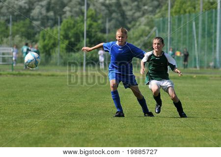 KAPOSVAR, HUNGARY - JUNE 12: Unidentified players in action at the Hungarian National Championship under 13 game between Kaposvari Rakoczi and Tatabanya June 12, 2010 in Kaposvar, Hungary.