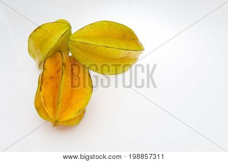 Star fruit on white isolated background translucent delicious natural sweet shape starfruit food texture detail macro close up carambola