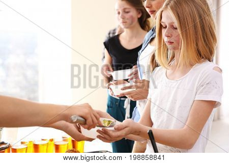 Volunteer giving food to poor people. Poverty concept