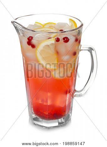 Glass jug of cold lemonade on white background