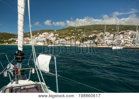 View of the Marina at Andros island from sailing boat, Aegean sea, Greece.