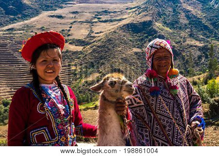 Native Peruvian group with their Llama in Sacred Valley, Cusco, Peru