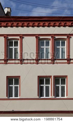 the decorated windows of the old building