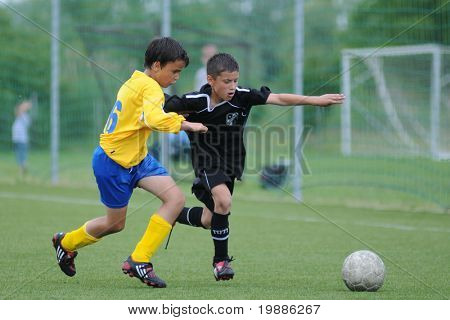 KAPOSVAR, HUNGARY - JUNE 5: Roland Vajda (R) in action at the Hungarian National Championship under 13 game between Kaposvari Rakoczi and Siofok B June 5, 2010 in Kaposvar, Hungary.