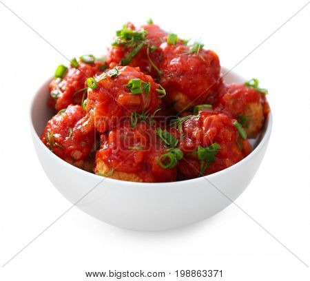 Bowl with delicious turkey meatballs and tomato sauce on white background