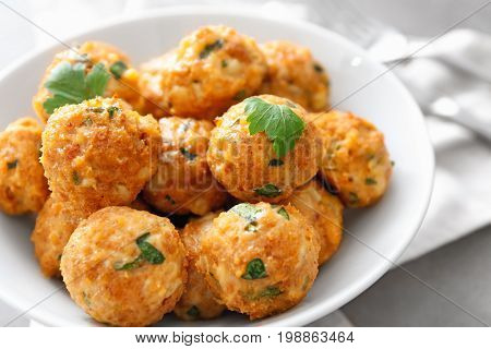 Bowl with delicious turkey meatballs on table, closeup
