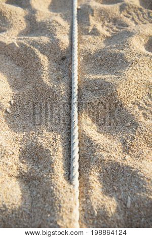 Boundary line. Beach rope line commonly used for seaside sports such as beach volley. Also used for showing areas or property boundries on a beach.