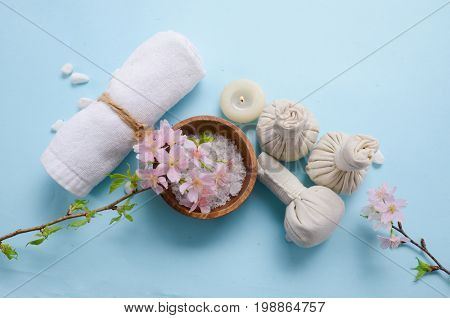pink cherry ,salt in bowl, candle,soap ,oil, with herbal ballon blue background