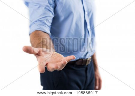 Man pretending to be holding invisible object against white background