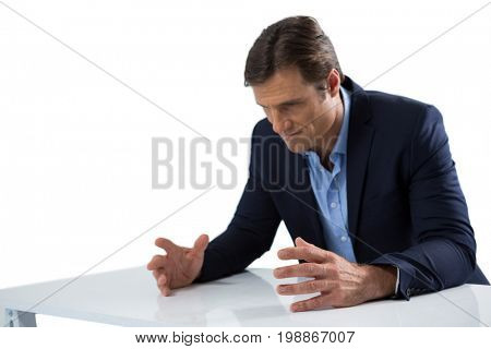 Frustrated businessman gesturing against white background