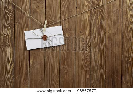 Envelope pinned to rope