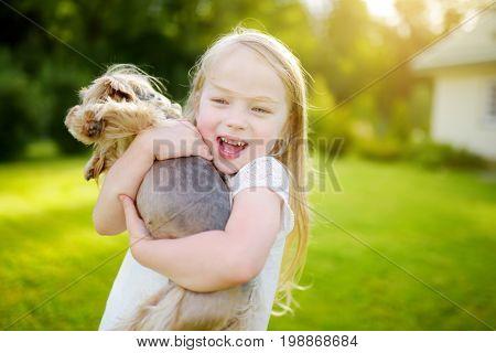Cute Little Girl Holding Her Funny Yorkshire Terrier Dog