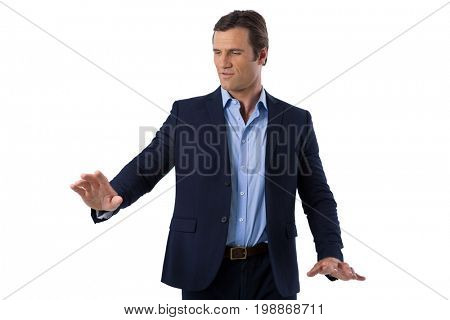 Businessman touching the invisible screen against white background