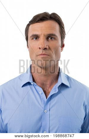 Portrait of male executive against white background