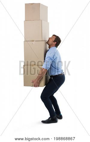 Male executive carrying stack of cardboard boxes against white background