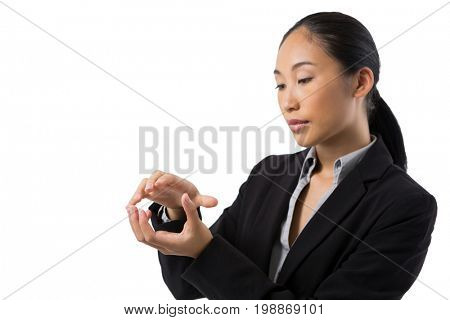 Businesswoman holding invisible object against white background