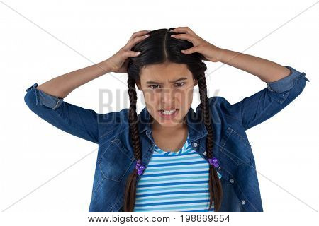 Portrait of frustrated girl scratching her head against white background