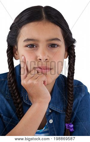 Portrait of girl with hand on chin against white background