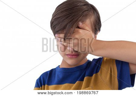 Cute boy covering his eyes. See no evil concept