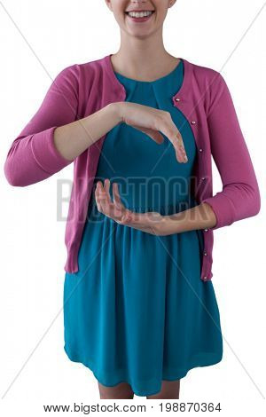 Mid section of teenage girl pretending to be hold invisible object