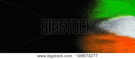 Indian Republic Day celebration background banner. Red, green and saffron color powders splashed over dark background.