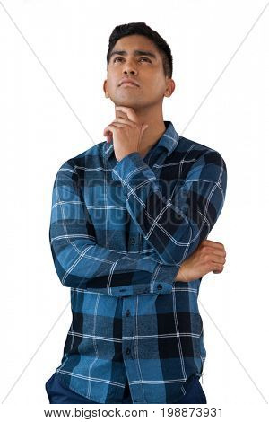 Thoughtful young man with hand on chin looking up