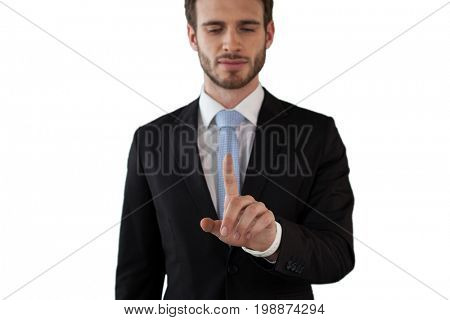 Businessman touching index finger on invisible interface against white background