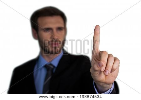 Close up of businessman touching index finger on invisible interface against white background
