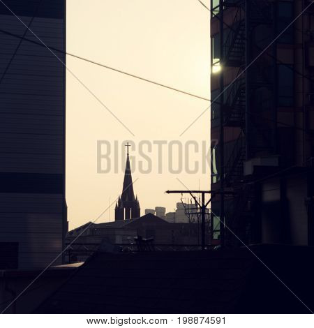 Seoul - July 2017: Silhouette cityscape with church in evening light.