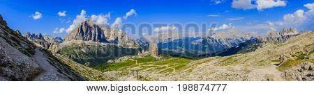 Great panorama view of the top Tofana di Rozes and Cinque Torri range in  Dolomites, South Tyrol. Location Cortina d'Ampezzo, Italy, Europe. Dramatical cloudy scene. Beauty of mountains world.