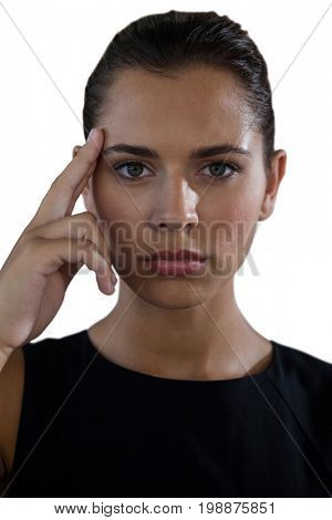 Portrait of thoughtful businesswoman against white background