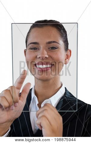 Close up portrait of young businesswoman using glass interface against white background