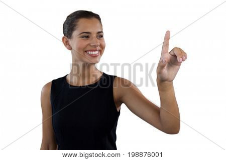 Happy businesswoman touching invisible interface screen against white background