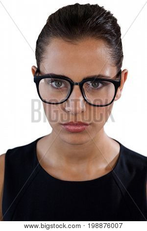 Portrait of young businesswoman wearing eyeglasses against white background