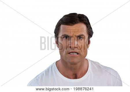 Portrait of surprised mature man against white background
