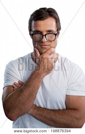 Portrait of mature man with hand on chin against white background