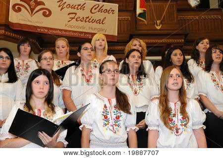 KAPOSVAR, HUNGARY - AUGUST 26: Members of the Kodaly Zoltan Grammar School Choir sing at the IV. Pannonia Cantat Youth Choir Festival August 26, 2010 in Kaposvar, Hungary