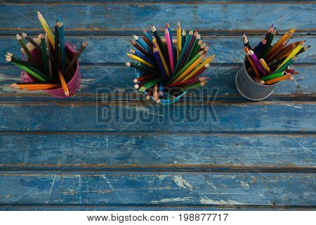 Overhead view of color pencils arranged in pencil holder