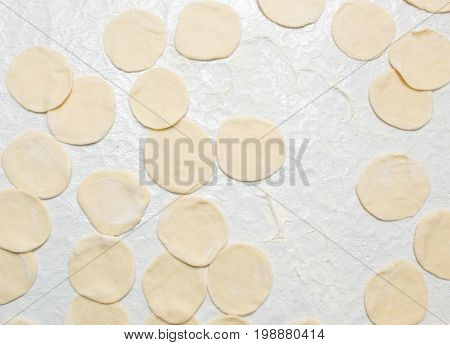 Cook cooks dough for pieces in the kitchen