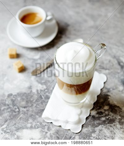 Glass of Latte Macchiato and a Cup of Espresso