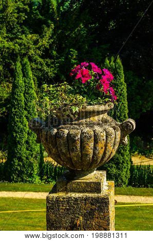 Concrete Flower Pots In The Garden On A Pedestal Stylized Antique, A Place Of Rest, Practical Urban
