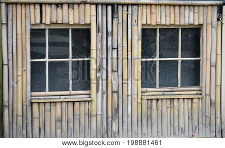 two window panes with bamboo framed siding