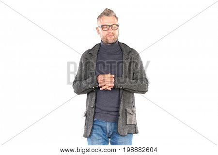 Studio portrait of middle aged man wearing casual clothing and eyeglasses