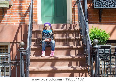 Old houses with stairs in historic district of West Village