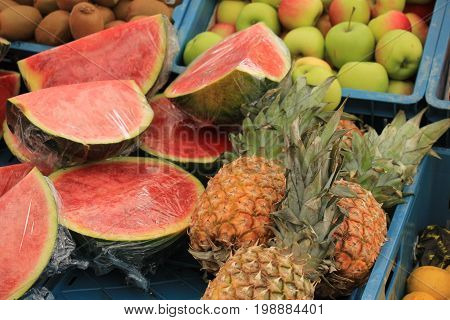 Fresh fruit on a market stall watermelon and pineapples