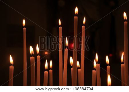 Long thin candles in a roman catholic church
