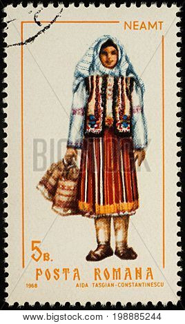 Moscow Russia - August 08 2017: A stamp printed in Romania shows young woman in Romanian national costume Neamt county series