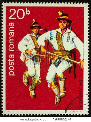 Moscow Russia - August 08 2017: A stamp printed in Romania shows two Romanian folk dancers series